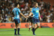Stephen Perofeta (L) of the Blues shakes hands with team mate Michael Collins (R) after the round eight Super Rugby match between the Chiefs and the Blues at Waikato Stadium on April 7, 2018 in Hamilton, New Zealand.
