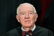 Associate Justice John Paul Stevens poses during a group photograph at the Supreme Court building on September 29, 2009 in Washington, DC. The high court made a new group photograph with its newest member Associate Justice Sonia Sotomayor.