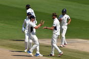 Ollie Rayner of Middlesex (R) celebrates with Hilton Cartwright after dismissing Danny Briggs of Sussex during the Specsavers County Championship Division Two match between Sussex and Middlesex at The 1st Central County Ground on May 7, 2018 in Hove, England.