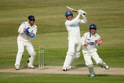 Dominic Cork of Hamshire hits out as Andrew Hodd of Sussex takes evasive action during the first day of the LV County Championship Division One match between Sussex and Hampshire at the PROBIZ County Ground on July 11, 2011 in Hove, England.
