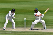 Mark Pettini of Leicestershire hits the two runs he needs to reach his century as wicketkeeper Ben Brown of Sussex looks on during the Specsavers County Championship Division Two match between Sussex and Leicestershire on May 03, 2016 in Hove, England.