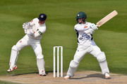 Alexei Kervezee of Gloucestershire cuts for four as wicketkeeper Ben Brown of Sussex looks on during the LV County Championship match between Sussex and Gloucestershire at BrightonandHoveJobs.com County Ground on April 20, 2015 in Hove, England.