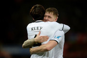 Ki Sung-Yueng of Swansea City celebrates scoring his side's first goal with Alfie Mawson during the Premier League match between Swansea City and Burnley at Liberty Stadium on February 10, 2018 in Swansea, Wales.