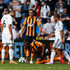 Dame N'Doye Photos - Ashley Williams of Swansea City confronts Dame N'Doye of Hull City during the Barclays Premier League match between Swansea City and Hull City at Liberty Stadium on April 4, 2015 in Swansea, Wales. - Swansea City v Hull City - Premier League