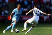 Glen Johnson of Stoke City takes on Tom Carroll of Swansea City during the Premier League match between Swansea City and Stoke City at the Liberty Stadium on April 22, 2017 in Swansea, Wales.
