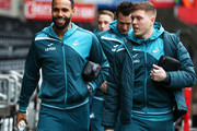 Kyle Bartley and Alfie Mawson of Swansea City arrive prior to The Emirates FA Cup Quarter Final match between Swansea City and Tottenham Hotspur at Liberty Stadium on March 17, 2018 in Swansea, Wales.