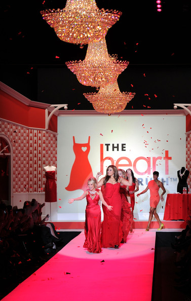 Actress Kristin Chenoweth, singer Jordin Sparks, and actress Regina King walk the runway during Swarovski at the Red Dress Collection 2010 Fashion Show during Mercedes-Benz Fashion Week at The Tent at Bryant Park on February 11, 2010 in New York City.