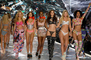 (L-R) Nadine Leopold, Shanina Shaik, Herieth Paul, Barbara Fialho, Toni Garrn, and Cheyenne Maya Carty walk the runway in the 2018 Victoria's Secret Fashion Show at Pier 94 on November 8, 2018 in New York City.