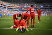 Harry Maguire of England celebrates with teammates after scoring his team's first goal during the 2018 FIFA World Cup Russia Quarter Final match between Sweden and England at Samara Arena on July 7, 2018 in Samara, Russia.