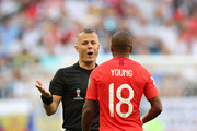 Referee Bjorn Kuipers speaks with Ashley Young of England during the 2018 FIFA World Cup Russia Quarter Final match between Sweden and England at Samara Arena on July 7, 2018 in Samara, Russia.