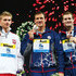 Ryan Lochte Tyler Clary Photos - (L-R) Silver medal winner Radoslaw Kawecki of Poland, Gold medal winner Ryan Lochte of the USA and Bronze medal winner Tyler Clary of the USA celebrate on the podium after the Swimming Men's Backstroke 200m Final on day fourteen of the 15th FINA World Championships at Palau Sant Jordi on August 2, 2013 in Barcelona, Spain. - Swimming - 15th FINA World Championships: Day Fourteen