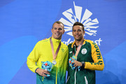 Silver medalists Kyle Chalmers of Australia (L) and Chad le Clos of South Africa pose during the medal ceremony for the Men's 100m Freestyle Final on day four of the Gold Coast 2018 Commonwealth Games at Optus Aquatic Centre on April 8, 2018 on the Gold Coast, Australia.