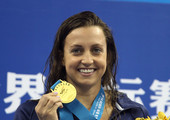 Gold medalist Rebecca Soni of the United States poses with her medal after the Women's 100m Breaststroke Final during Day Eleven of the 14th FINA World Championships at the Oriental Sports Center on July 26, 2011 in Shanghai, China.