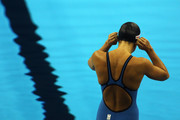 Rebecca Soni of the United States adjusts her cap as she gets set to swim in the Women's 50m Breaststroke Semi Final during Day Fifteen of the 14th FINA World Championships at the Oriental Sports Center on July 30, 2011 in Shanghai, China.