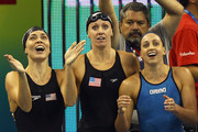 (L-R) Natalie Coughlin, Dana Vollmer and Rebecca Soni of the United States cheer on Melissa Franklin on the way to winning the gold medal in the Women's 4x100m Medley Relay during Day Fifteen of the 14th FINA World Championships at the Oriental Sports Center on July 30, 2011 in Shanghai, China.