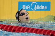 Rebecca Soni of the United States looks at the results board after winning the gold medal in the Women's 200m Breaststroke Final during Day Fourteen of the 14th FINA World Championships at the Oriental Sports Center on July 29, 2011 in Shanghai, China.