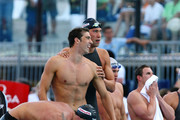 (L-R) Ryan Lochte shakes the hand of Nathan Adrian as Michael Phelps and Mattew Grevers of the United States celebrate victory in the Men's 4x 100m Freestyle Final during the 13th FINA World Championships at the Stadio del Nuoto on July 26, 2009 in Rome, Italy.