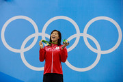 Gold medalist Rie Kaneto of Japan poses on the podium during the medal ceremony for the Women's 200m Breaststroke Final on Day 6 of the Rio 2016 Olympic Games at the Olympic Aquatics Stadium on August 11, 2016 in Rio de Janeiro, Brazil.