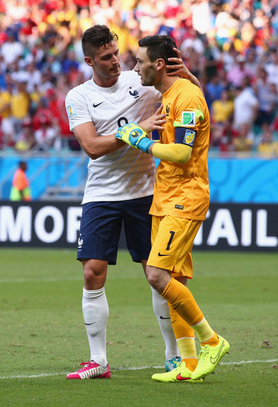Olivier Giroud of France reacts with his goalkeeper Hugo Lloris during the 2014 FIFA World Cup Brazil Group E match between Switzerland and France at Arena Fonte Nova on June 20, 2014 in Salvador, Brazil.