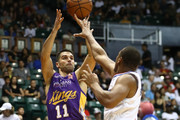 Kevin Lisch #11 of the Sydney Kings shoots one Avery Bradley #11 of the Los Angeles Clippers during the third quarter at the Stan Sheriff Center on September 30, 2018 in Honolulu, Hawaii.