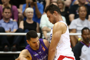 Kevin Lisch #11 of the Sydney Kings is has his dribble drive stalled by Danilo Gallinari #8 of the Los Angeles Clippers during the first quarter at the Stan Sheriff Center on September 30, 2018 in Honolulu, Hawaii.