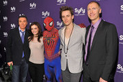 (L-R) Actors Patrick Page, Jennifer Damiano, Spiderman, Reeve Carney, and Syfy President Dave Howe attend the Syfy 2011 Upfront at the Foxwoods Theater on March 22, 2011 in New York City.