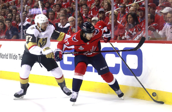 2018 NHL Stanley Cup Final - Game Four [oshie 77,player,sports,ice hockey,tournament,college ice hockey,hockey protective equipment,team sport,sports gear,defenseman,hockey,shea theodore,four,puck,nhl,washington capitals,vegas golden knights,stanley cup final,battle,game four]