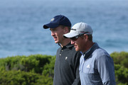Professional football player Peyton Manning and Greg Owen of England walk off the 13th tee during the first round of the AT&T Pebble Beach National Pro-Am at Monterey Peninsula Country Club on February 6, 2014 in Pebble Beach, California.
