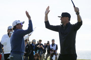 Actor Josh Duhamel celebrates with music artist Clay Walker after playing his shot from the 18th tee during the 3M Celebrity Challenge prior to the AT&T Pebble Beach Pro-Am at Pebble Beach Golf Links on February 05, 2020 in Pebble Beach, California.