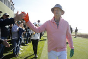 Actor Bill Murray high fives fans during the 3M Celebrity Challenge prior to the AT&T Pebble Beach Pro-Am at Pebble Beach Golf Links on February 05, 2020 in Pebble Beach, California.