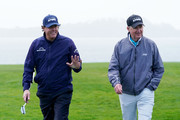 Phil Mickelson of the United States and Scott Ozanus, Deputy Chairman and Chief Operating Officer of KPMG, walk on the eighth hole during the third round of the AT&T Pebble Beach Pro-Am at Pebble Beach Golf Links on February 09, 2019 in Pebble Beach, California.