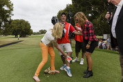 Torah Bright (R) and Kerri-Anne Kennerley tend to a Channel 7 cameraman after Bright's wayward tee shot hit struck him in the shins at the Tag Heuer Hole in One Challenge at Royal Sydney Golf Club on November 19, 2016 in Sydney, Australia.