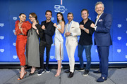 (L-R) Olivia Culpo, Catherine Eberle, Jean-Eric Vergne, Paulina Vega, Patrick Dempsey, Alejandro Agag and Andrea Soriani pose on stage during a TAG Heuer celebration of  50 years of the iconic Monaco Timepiece with brand ambassador Patrick Dempsey on July 10, 2019 in New York City.