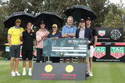 Kris Smith, Matt Suleau, Phil Davis, Andrew Gaze and Ed Jenkins pose with Pierre Blouin and Briony Lyle during the TAG Heuer Million Dollar Celebrity Golf Challenge for Challenge Cancer at The Lakes Golf Club on November 17, 2018 in Sydney, Australia.