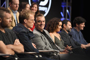 (Top L-R) Actors Jeremy Bobb, Elizabeth Reaser and Lynn Collins (Bottom L-R) Actors Sam Worthington, Paul Bettany, Chris Noth, Keisha Castle Hughes, Showrunner/executive producer/director Greg Yaitanes and Executive producer/writer Andrew Sodroski at the 'Manhunt: Unabomber' panel for the 'Discovery Channel - Discovery' portion of the TCA Summer Event 2017 at The Beverly Hilton Hotel on July 26, 2017 in Beverly Hills, California.