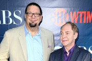 Illusionists Penn Jillette (L) and Teller of Penn & Teller attend the CBS, The CW, Showtime & CBS Television Distribution's 2014 TCA Summer Press Tour Party at Pacific Design Center on July 17, 2014 in West Hollywood, California.