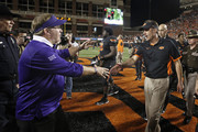 Head Coach Gary Patterson of the TCU Horned Frogs and head coach Mike Gundy of the Oklahoma State Cowboys meet after the game November 7, 2015 at Boone Pickens Stadium in Stillwater, Oklahoma. The Cowboys defeated the Horned Frogs 49-29.