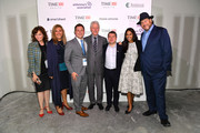 Former U.S. President Bill Clinton (C), Editor-in-Chief & CEO at TIME, Edward Felsenthal, and TIME owner Marc Benioff (R) pose with members of TIME staff during the TIME 100 Health Summit at Pier 17 on October 17, 2019 in New York City.