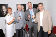(L ro R) Admiral Dawn Cutler, Secretary of the Navy Ray Mabus, Actor Eric Dane and Executive producer Steven Kane show their Challenge Coins backstage at the TNT 'The Last Ship' Washington D.C. Screening at The Newseum on June 12, 2015 in Washington, DC.