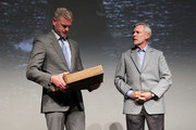 The Secretary of the Navy Ray Mabus (R)  presents actor Eric Dane with a Shadow Box containing Navy medals earned by his father at the TNT 'The Last Ship' Washington D.C. Screening at The Newseum on June 12, 2015 in Washington, DC.