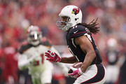 Wide receiver Larry Fitzgerald #11 of the Arizona Cardinals runs with the football after a reception against the Tampa Bay Buccaneers during the first half of the NFL game at the University of Phoenix Stadium on October 15, 2017 in Glendale, Arizona.