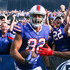 Logan Thomas Photos - Logan Thomas #82 of the Buffalo Bills celebrates with fans after scoring a touchdown during the third quarter of an NFL game against the Tampa Bay Buccaneers on October 22, 2017 at New Era Field in Orchard Park, New York. - Tampa Bay Buccaneers vBuffalo Bills