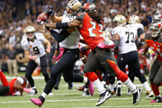 Mark Barron #23 of the Tampa Bay Buccaneers defends a pass intended for Jimmy Graham #80 of the New Orleans Saints during the first quarter of a game at the Mercedes-Benz Superdome on October 5, 2014 in New Orleans, Louisiana.