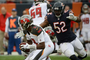 Khalil Mack #52 of the Chicago Bears charges toward quarterback Jameis Winston #3 of the Tampa Bay Buccaneers in the third quarter at Soldier Field on September 30, 2018 in Chicago, Illinois.