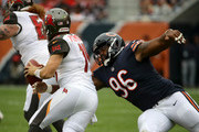 Akiem Hicks #96 of the Chicago Bears takes down quarterback Ryan Fitzpatrick #14 of the Tampa Bay Buccaneers in the first quarter at Soldier Field on September 30, 2018 in Chicago, Illinois.
