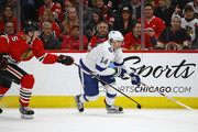 Chris Kunitz #14 of the Tampa Bay Lightning advances the puck past Connor Murphy #5 of the Chicago Blackhawks at the United Center on January 22, 2018 in Chicago, Illinois.