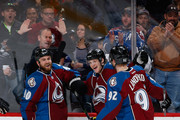 Nathan MacKinnon #29 of the Colorado Avalanche celebrates his second goal of the night with Ryan O'Reilly #90 and Gabriel Landeskog #92 of the Colorado Avalanche to take a 2-1 lead over the Tampa Bay Lightning in the second period at Pepsi Center on February 22, 2015 in Denver, Colorado.