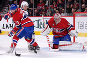 Goalie Carey Price #31 of the Montreal Canadiens looks for the rebounding puck in front of Tyler Johnson #9 and teammate Andrei Markov #79 during the NHL game at the Bell Centre on March 10, 2015 in Montreal, Quebec, Canada.