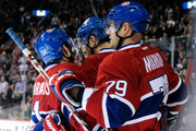 Members of the Montreal Canadiens celebrate the second period goal from teammate Erik Cole #72 during the NHL game against the Tampa Bay Lightning at the Bell Centre on April 4, 2012 in Montreal, Quebec, Canada.  The Canadiens defeated the Lightning 5-2.