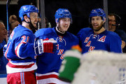 Derek Stepan #21 celebrates with Jesper Fast #19 and Dan Girardi #5 of the New York Rangers after scoring a second period goal against the Tampa Bay Lightning in Game One of the Eastern Conference Finals during the 2015 NHL Stanley Cup Playoffs at Madison Square Garden on May 16, 2015 in New York City.